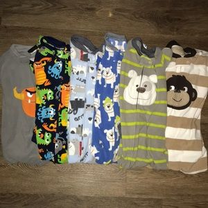 Bundle of 6 fleece toddler footie pajamas.